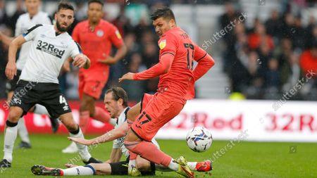 Stock Photo of Joel Piroe of Swansea tries a shot on goal but is stopped by Richard Stearman of Derby