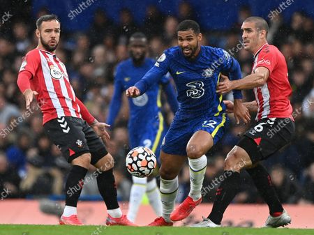 Chelsea's Ruben Loftus-Cheek (C) in action against Southampton's Adam Armstrong (L) and Oriol Romeu (R) during the English Premier League soccer match between Chelsea FC and Southampton FC in London, Britain, 02 October 2021.