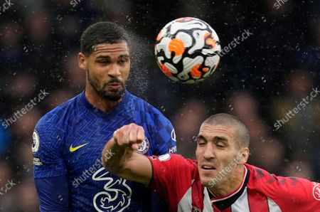 Chelsea's Ruben Loftus-Cheek,left, duels for the ball with Southampton's Oriol Romeu during the English Premier League soccer match between Chelsea and Southampton at Stamford Bridge Stadium in London