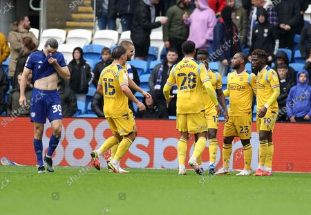 Junior Hoilett of Reading celebrates scoring a goal with team mates.