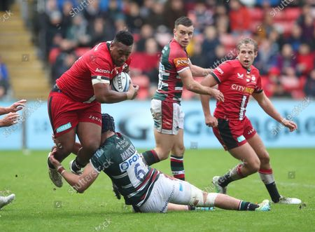 Eroni Mawi of Saracens is tackled by George Martin of Leicester