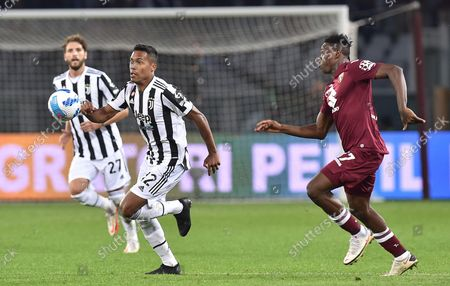 Torino's Wilfred Singo (R) and Juventus' Alex Sandro in action during the Italian Serie A soccer match Torino FC vs Juventus FC at Olimpico Grande Torino Stadium in Turin, Italy, 02 October 2021.