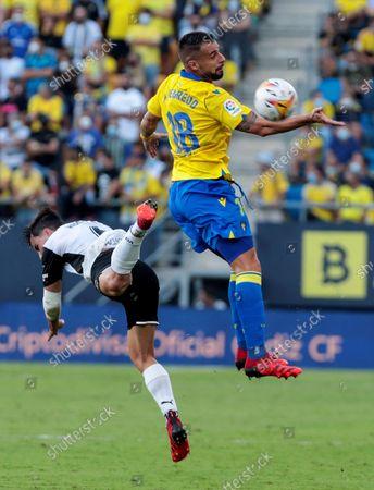 Cadiz's striker Alvaro Negredo (R) duels for the ball with Valencia's defender Hugo Guillamon (L) during the Spanish LaLiga soccer match Cadiz CF and Valencia CF at Estadio Nuevo Mirandilla stadium in Cadiz, Andalusia, Spain, 02 October 2021.