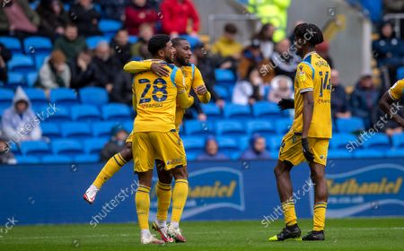 Junior Hoilett of Reading FC celebrates with Josh Laurent after he scores the opening goal to put Reading 1-0 up