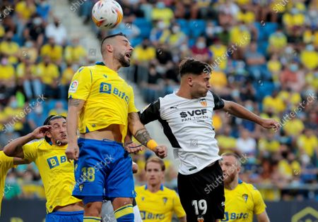 Cadiz's striker Alvaro Negredo (L) duels for the ball with Valencia's striker Hugo Duro (R) during their Portuguese First League soccer match held at Dragao Stadium in Porto, Portugal, 02 October 2021.