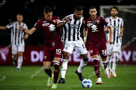 Juventus defender Alex Sandro (12) fights for the ball against Torino midfielder Sasa Lukic (10) during the Serie A football match n.7 TORINO - JUVENTUS on October 02, 2021 at the Stadio Olimpico Grande Torino in Turin, Piedmont, Italy. Final result: Torino-Juventus 0-1.
