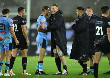 Rhys Priestland of Cardiff and Bradley Davies of Ospreys at the end of the game.