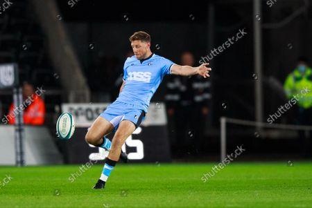 Rhys Priestland of Cardiff Rugby kicks the ball.