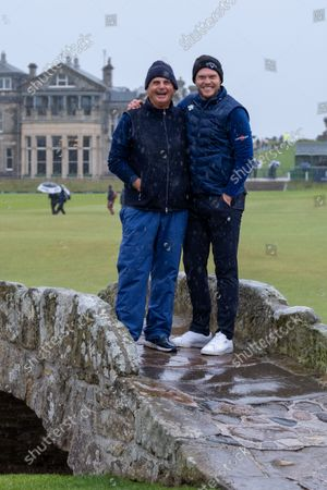 Jimmy Dunne and Danny Willett smiling in the rain on the Swilken Bridge, The Old Course.