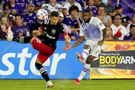 United midfielder Felipe Martins (8) blocks a pass from Orlando City defender Ruan (2) during the first half of an MLS soccer match, in Orlando, Fla