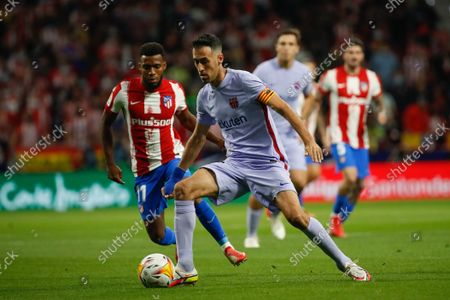 Sergio Busquets of FC Barcelona in action with Thomas Lemar of Atletico de Madrid during the La Liga match between Atletico de Madrid and FC Barcelona at Wanda Metropolitano Stadium in Madrid, Spain.