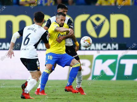 Alvaro Negredo of Cadiz CF and Hugo Guillamon and Omar Alderete of Valencia CF