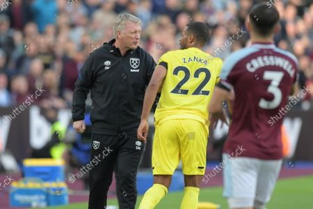 David Moyes Manager of West Ham Utd clashes with Mathias Zanka Jørgensen of Brentford over a throw in during the West Ham vs Brentford Premier League match at the London Stadium Stratford.