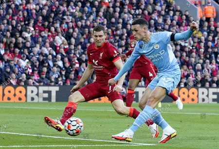 Phil Foden (R) of Manchester City in action against James Milner (L) of Liverpool during the English Premier League soccer match between Liverpool FC and Manchester City in Liverpool, Britain, 03 October 2021.
