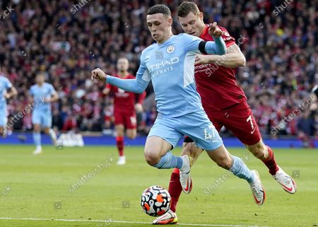 Phil Foden (L) of Manchester City in action against James Milner (R) of Liverpool during the English Premier League soccer match between Liverpool FC and Manchester City in Liverpool, Britain, 03 October 2021.