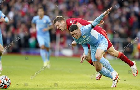 Phil Foden (front) of Manchester City in action against James Milner (back) of Liverpool during the English Premier League soccer match between Liverpool FC and Manchester City in Liverpool, Britain, 03 October 2021.