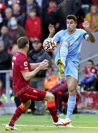 Joao Cancelo (R) of Manchester City in action against James Milner (L) of Liverpool during the English Premier League soccer match between Liverpool FC and Manchester City in Liverpool, Britain, 03 October 2021.