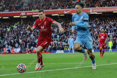 Jack Grealish and James Milner tussle for the ball.