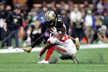 New Orleans Saints running back Alvin Kamara (41) is tackles by New York Giants cornerback Adoree' Jackson (22) during an NFL football game, in New Orleans