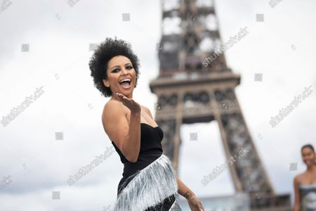 Kat Graham wears a creation for the L'Oreal Spring-Summer 2022 ready-to-wear fashion show presented in Paris