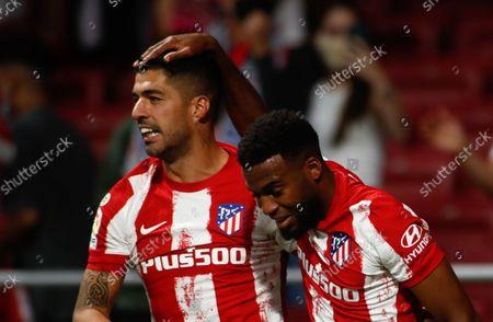 Thomas Lemar of Atletico de Madrid celebrates a goal with Luis Suarez