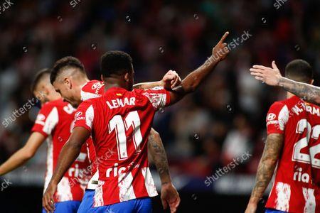 Thomas Lemar of Atletico de Madrid celebrates a goal with teammates