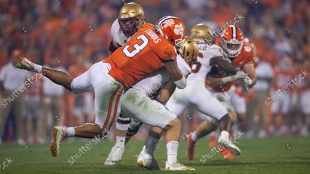 Stock Picture of Clemson defensive end Xavier Thomas (3) tackles Boston College quarterback Dennis Grosel (6) during the second half of an NCAA college football game, against Boston College, in Clemson, S.C