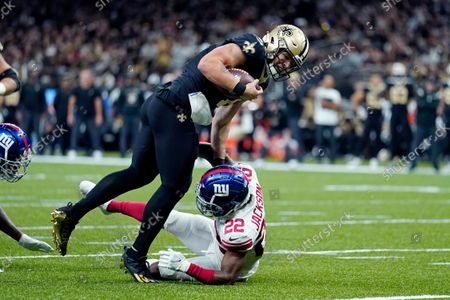New Orleans Saints quarterback Taysom Hill hits New York Giants cornerback Adoree' Jackson (22) on a touchdown carry in the second half of an NFL football game in New Orleans