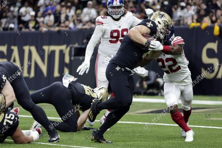 New Orleans Saints quarterback Taysom Hill (7) carries for a touchdown against New York Giants cornerback Adoree' Jackson (22) in the second half of an NFL football game in New Orleans