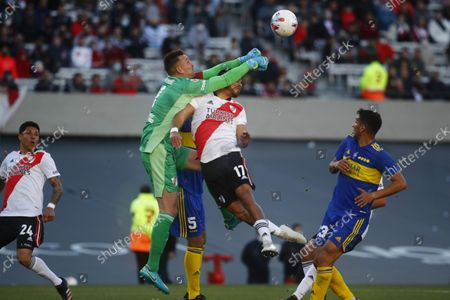 River Plate's goalkeeper Franco Armani, punches out the ball over his teammate Paulo Diaz during a local tournament soccer match against Boca Juniors at Antonio Liberti Vespucio stadium in Buenos Aires, Argentina