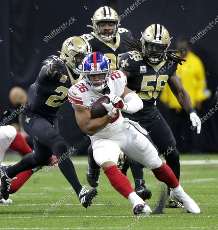 New York Giants running back Saquon Barkley (26) runs the ball against the New Orleans Saints defense at the Caesars Superdome in New Orleans on Sunday, October 3, 2021.
