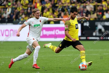 (211003) - DORTMUND, Oct. 3, 2021 (Xinhua) - Emre Can (R) of Dortmund lives with Hans Frederik Jensen of Augsburg during the German first division Bundesliga football match between Borussia Dortmund and FC Augsburg in Dortmund, Germany, Oct. 2, 2021.
