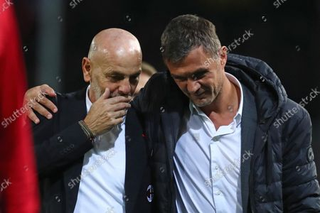 Milan's head coach Stefano Pioli (L) and Milan's manager Paolo Maldini (R) react after winning the Italian Serie A soccer match between Atalanta BC and AC Milan in Bergamo, Italy, 03 October 2021.