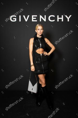 Caroline Daur poses for photographers prior to the Givenchy Spring-Summer 2022 ready-to-wear fashion show presented in Paris