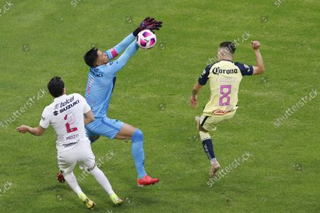 Pumas' goalkeeper Alfredo Talavera, center, blocks a shot by America's Alvaro Fidalgo (8) during a Mexican Soccer League match at Azteca stadium in Mexico City