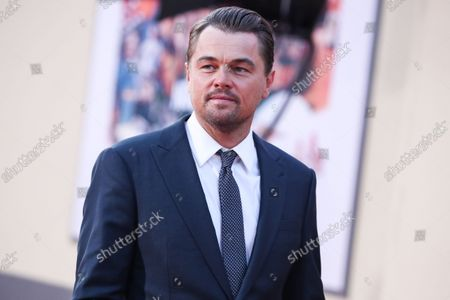 Actor Leonardo DiCaprio wearing Giorgio Armani with Oliver Peoples sunglasses and David Yurman cufflinks arrives at the World Premiere Of Sony Pictures' 'Once Upon a Time In Hollywood' held at the TCL Chinese Theatre IMAX on July 22, 2019 in Hollywood, Los Angeles, California, United States.