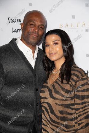 Stock Photo of (L-R) Chris Spencer and Vanessa Rodriguez Spencer