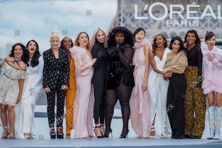 (L-R) Camila Cabello, Aishwarya Rai Bachchan, Helen Mirren, Aja Naomi King, Amber Heard, Soo Joo Park, Yseult, Nidhi Sunil, Leila Bekhti, Liya Kebede and Luma Grothe on the catwalk