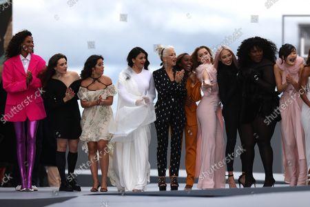 Aja Naomi King, Camila Cabello, Helen Mirren, Amber Heard, Aishwarya Rai , Soo Joo Park attends the 'Le Defile L'Oreal Paris 2021' show as part of Paris Fashion Week on October 03, 2021 in Paris, France.