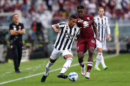 Alex Sandro of Juventus Fc controls the ball during the Serie A match between Torino Fc and Juventus Fc.
