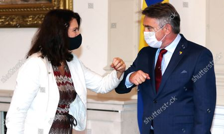 Chairman of the tripartite Presidency of Bosnia and Herzegovina Zeljko Komsic (R) welcomes Swedish Minister of Foreign Affairs Ann Linde (L) to meeting, in Bosnian Presidency in Sarajevo, Bosnia and Herzegovina, 04 October 2021.