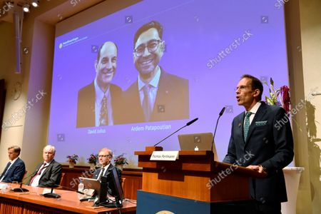 Thomas Perlmann, Secretary of the Nobel Assembly and the Nobel Committee announces the winners of the 2021 Nobel Prize in Physiology or Medicine during a press conference at the Karolinska Institute in Stockholm, Sweden, on October 5, 2020. The 2021 Nobel Prize in physiology and medicine has been awarded to David Julius and Ardem Patapoutian (seen on the screen) for their discoveries of receptors for temperature and touch.