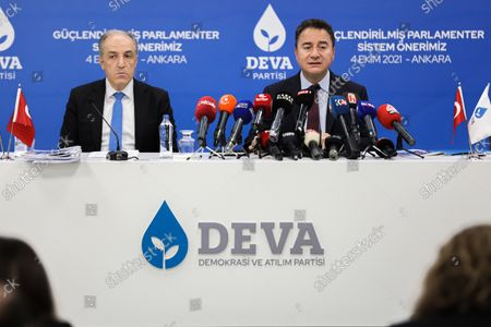 """Stock Picture of DEVA Chairman Ali Babacan (R) speaks during a press conference. Democracy and Progress Party (DEVA) Chairman Ali Babacan announced the """"Reinforced Parliamentary System"""" work at the party's headquarters."""