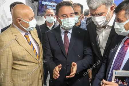"""Stock Image of DEVA Chairman Ali Babacan (M) arrive at the press conference. Democracy and Progress Party (DEVA) Chairman Ali Babacan announced the """"Reinforced Parliamentary System"""" work at the party's headquarters."""