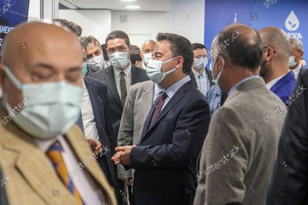 """DEVA Chairman Ali Babacan (M) arrive at the press conference. Democracy and Progress Party (DEVA) Chairman Ali Babacan announced the """"Reinforced Parliamentary System"""" work at the party's headquarters."""