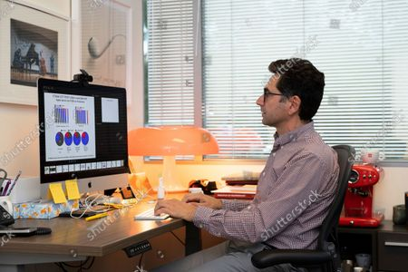 Dr. Ardem Patapoutian works in his office at the Dorris Neuroscience Center, in San Diego. Two scientists, Americans Patapoutian and David Julius won the Nobel Prize in medicine on Monday, for their discoveries into how the human body perceives temperature and touch
