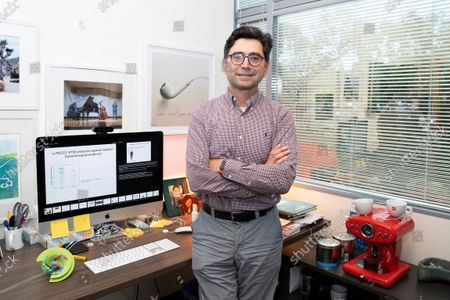 Stock Picture of Ardem Patapoutian poses for a portrait in his office at the Dorris Neuroscience Center, in San Diego. Two scientists, Americans Patapoutian and David Julius, won the Nobel Prize in medicine for their discoveries into how the human body perceives temperature and touch