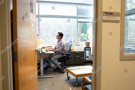 Ardem Patapoutian works in his office at the Dorris Neuroscience Center, in San Diego. Two scientists, Americans Patapoutian and David Julius, won the Nobel Prize in medicine for their discoveries into how the human body perceives temperature and touch