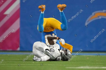 Stock Image of Las Vegas Raiders receiver Henry Ruggs III (11) can't come up with catch against Los Angeles Chargers cornerback Michael Davis in fourth quarter action at SoFi Stadium on Monday, October 4, 2021 in Inglewood, California. The Chargers defeated the Raiders 28-14.