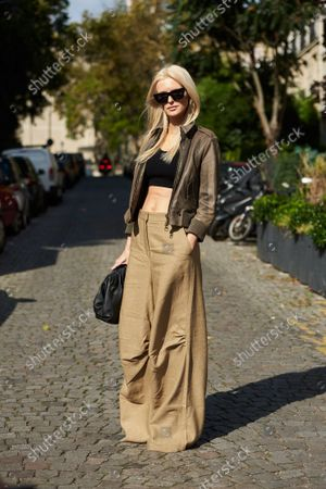 Editorial picture of Street Style, Spring/Summer 2022, Paris Fashion Week, Paris, France - 04 Oct 2021